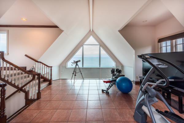 Fitness room with water views at ocean front home